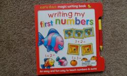 "With kid-friendly themes and delightful illustrations, this ""magic writing"" book makes math approachable and interesting. With the help of an easy-to-use stylus and slide-out rub-clean board, kids will learn to recognize numbers, count, and do basic"