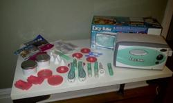 This Easy Bake Oven is in excellent condition and comes with an array of baking acessories to make cookies and cakes (shapes, frosting wands, cake pans, recipes, cake mixes, frosting mixes).  Original instructions and box included. This would make a