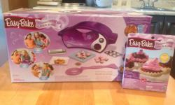 Easy bake oven for sale with some accessories included such and cookie cutters, and mix.