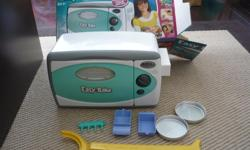 Pre-owned Easy Bake Oven. Comes with original box, instructions, and accessories as shown. Light bulb included! Located in Barrhaven