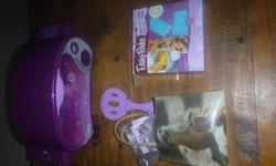 This easy bake oven, my daughter has hardly used it, comes with a number of mixes and accessories and addons.