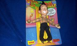 Move over Garfield, Ed Grimley is here! This is an Ed Grimley doll with suction cups on hands and feet so you can stick him anywhere! Made by Tyco in 1989, this Ed Grimley doll comes in its original packaging and pays fitting tribute to Martin Short and