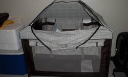 EDDIE BAUER PLAYARD This travel playpen comes complete with bassinet, change table, and canopy.  We had it at our house set up for our little grandson's visits.  Not used very much.  It was never used outside.  It is in brand new like condition.  We also
