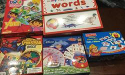Various educational board games and puzzles, excellent condition. Item list and prices below: -Little Einstein spin n seek eliminating card game- spinner game board with 36 cards. Age: 4+ $10 -Dora the explorer Yum Jr.- 4 illustrated game boards, dice,