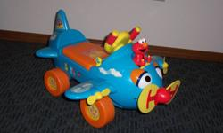Ride On Airplane With a front propeller that spins and lights up, this Sesame Street® Fly with Elmo Airplane Ride-On from Tek Nek® features talking phrases. The stars on the vehicle body light up, while the plane's eyes move. Moving the gear shift on the