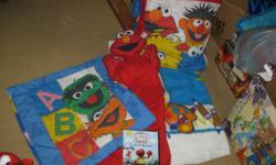 Sesame street and Elmo items   1 Soft fleecy twin size Elmo blanket 1 Quillow (it is a pillow and inside is a blanket that unfolds and it refolds back into the pillow case and is a pillow, handmade) 1 Sesame street pillow case (square pillow, quilted) 1