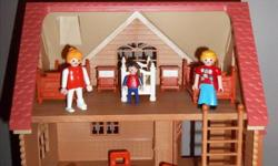 Beautiful vintage Sylvania family doll house with Playmobile furnitures. Include: 3 figurines 3 beds + 3 nightstands 2 benches + 1 small table 3 chairs +kitchen table 1 long stepping stone 7 animals + 2 fruits + 1 cage for the rabbits 1 canoe + 1 sleigh +