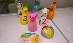Early Years bowling set plush with weighted bottom and bells