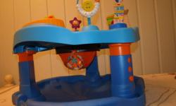 The Evenflo - ExerSaucer Activity Center Mega Splash features beach-themed toys that your baby will love. This Evenflo Mega ExerSaucer helps babies get the exercise they need to develop their neck, back, and leg muscles in addition to gross motor skills.