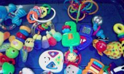 An assortment of baby toys / rattles, musical. Fisher Price, Elmo, Bright Starts, Playgro , Eden, Baby Einstein.
