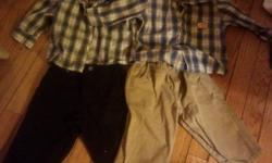 12 mnth. Like new. 2 dress shirts, black dress pant, khakis. Like new.