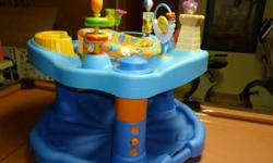 Colorful infant exersaucer Like new Bright and clean