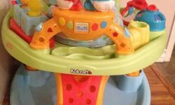 Exersaucer - Sesame Street - Kolcraft Converts to a walker Plays music (batteries included) Gender neutral colors Have instruction manual Pick up in Riverbend SE