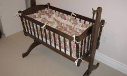 For Sale a wooden Baby Bassinet. The item is in great shape and swings back and forth. Great for new born babies. Asking $60.00