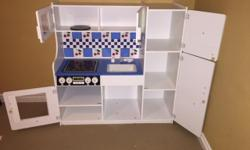 Excellent used condition. Melissa and Doug solid wood kitchen. Great for a playroom or daycare! Retails for about $250.