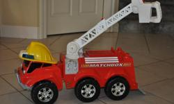 Large matchbox ride on toy fire engine with lights and sounds. Distinctive and lots of fun! Very good condition