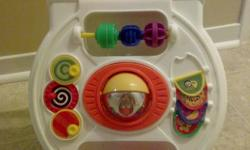 If you see Ad we still have it Infant walker that steady's baby's first steps and provides classic busy activities Activities include: flipping doors, sliding beads, turning gears, and spinning panels In the center is a ball that spins Encourages