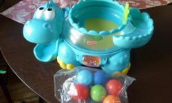 "Fisher-Price - Go Baby Go - Poppity Pop Musical Dino The Poppity Pop Dino is an adorable Dinosaur character and 6 brightly coloured balls. As baby bats at the roller ball, drops one of the balls down the dino's tail or onto his ""back"", the popping action"