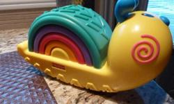 Fisher-Price Growing Baby: Rainbow Snail Stacker * The Growing Baby Rainbow Snail Stacker is a perfect first stacker for baby * Baby will love to stack the four colorful arches * Snail has wobbly base * Fun bat-at play that rewards baby with sound *