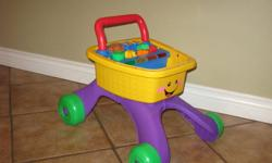 From amazon.com:   Walker features a wide steady wheel base and a comfortable grip handle for baby When baby walks music and lights encourage him to continue and sing along to ABCs and other learning songs There are four grocery items to shape and short