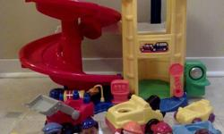 "Exciting Garage that delivers more toddler appropriate vehicle play Garage features: three story circular ramp; three story elevator with mechanical bell sounds as you raise and lower the elevator ""Automatic"" stop sign that lowers as elevator is raised"