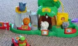 Fun Sounds Zoo-detailed, interactive playset. Playset has 3 habitats (Grasslands, Jungle, Water) with fun toddler activities on both sides, & room for multiple children to play at once! Comes with lion, polar bear & monkey figures.