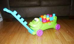 The Stack 'n Surprise Croc Block Wagon has 3 modes of play for babies and toddlers:   1)This cute character is the perfect building friend. There is a building surface on the Croc's back where baby can stack one or all of the 6 included blocks to get a