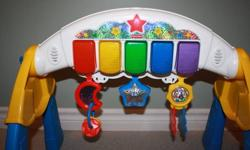 Fisher Price Piano Piano is adjustable depending on our childs age Baby can lay under and try to grab at the toy and watch the piano keys light up or when walking can standup and touch the keys to make their own music