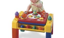 Fisher Price Spinning Tunes Activity Table and Fisher Price Brilliant Basics Singin' Snail Pail.   Spinning discs, fun music, silly sound effects and lots of activities add excitement to stacking and building fun! 1 side features 5 different areas that
