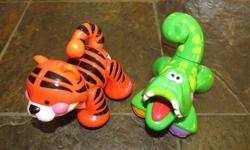 Tiger and Alligator that have parts that move and make sounds. Both 5 inches long.