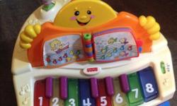 Fisher Price Laugh and Learn Baby Grand Piano with interactive song book, sing along songs and more.