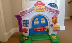 Interactive with music. The doorbell rings, the outdoor lights turn on and off, the door creaks when opened. Both sides have activities. For ages 6-36 months - has excellent reviews.