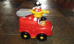 Includes fire truck, fireman, fire dog, makes sounds.