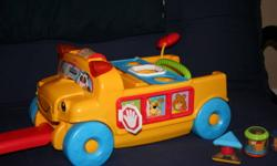 Fisher Price Peek-a-Block Bus $50 new 6 Block included. Plays music.