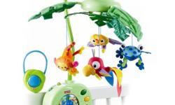Fisher-Price Rainforest Peek a Boo Leaves Musical Mobile.  Absolutely Mint/New condition.  Comes from clean non smoking no pet home.  Will attach easily to any crib.****************************************Shiny leaves wave gently up and down while a