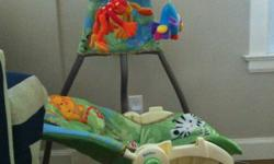 """Fisher Price Rainforest swing in excellent condition, rarely used. Purchased new for $179 + tax. Description from Sears website: """" For babies up to 25 lb. Deep cradle seat with 2-position seat recline Rotating mobile gently opens and closes around 3 plush"""