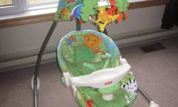 "$75- Located in Pine Grove Excellent condition   Fisher-Price Rainforest Open-Top Cradle Swing Baby takes a relaxing swing (side-to-side or front-to-back) as she watches plush rainforest friends in the mobile above play ""peek-a-boo"" among the leaves."