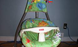 Fisher Price swing in excellent condition. Swings front to back and side to side. Optional music and moving characters. Several swing speeds. Plug-in or battery operated. Good up to 25 lbs.