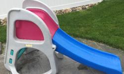Two stage slide that grows with your child. The pink portion can be removed to lower the slide. In excellent condition.
