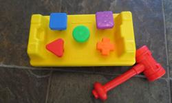 Tap or turn the different colour shapes with the included plastic hammer.
