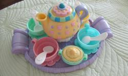 Complete 18 piece Fisher Price tea set - very good condition and tea wagon in excellent condition.