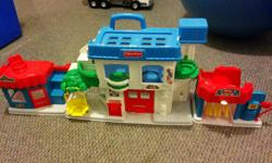 Vintage Fisher Price town - folds up and has carry handle. Car wash, fire station, mail box, swing, salon. Comes with fire truck and two figures.