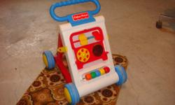 For Sale:Fisher Price training walker plus toy. New condition