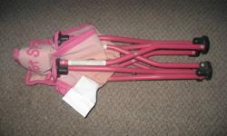 """Pink """"Tot Spot"""" chair, for small child, folds up, in good condition."""