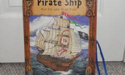 This is a cool pirate toy that folds-up like a big book then opens up into a pirate ship with paper characters. In very good condition. Asking $5.