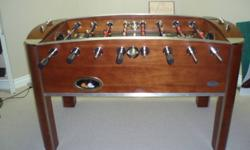 Deluxe polished wood foosball table.  Original cost over $600.  Barely used.  Excellent for games room.  Has both wooden and plastic handles that can be interchanged depending on preference.  We are now empty nesters so we are downsizing.