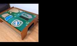Sturdy and strong wooden train table. Can also be used as a Lego table or as a general play table. Comes with hidden plastic storage bin underneath that slides under. 122cm long by 87cm deep by 42cm high For pick up on Saanich near Quadra and McKenzie.