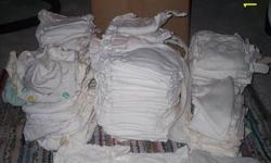 I have cloth diapers for sale from size newborn up to size 6.  There a many different styles of diaper but all are flannel with velcro.  Mostly white but some are printed.  Some have wear and some have some stains.  I also have included are liners of