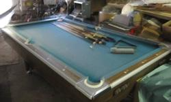 Full size pool table in excellent condition. Includes balls, several new Q-sticks, two wooden wall racks for sticks and balls. This does not have a slate top but is of very high quality and can be moved by 2-4 people.  A great Christmas gift idea !