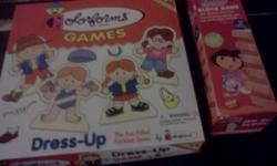 -Dora block game -Colorforms dress-up board game. Note that the clothes do not stick anymore on the dolls. That explain the price. Have all the parts. - 2 Dora card games   BUY the Dora block game at 2 $ and get other 3 for free !!!   PLEASE SEE MY OTHER